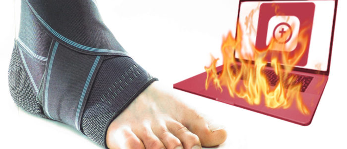 bandaged foot next to a Logos Bible Software laptop on fire